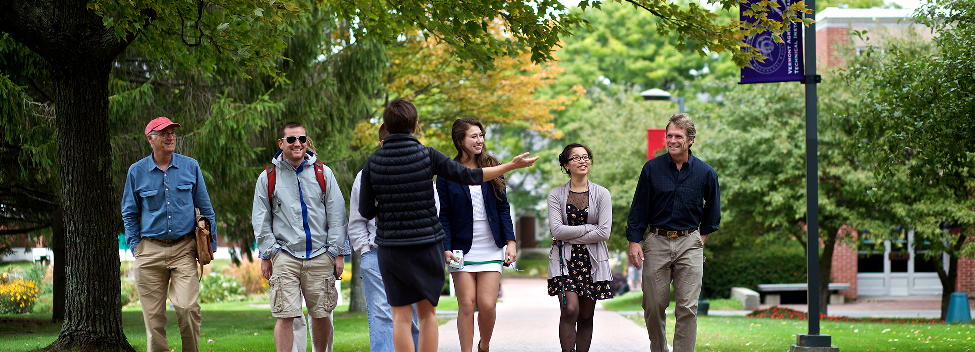 A Vermont Tech tour guide showing students around the Randolph Center Campus